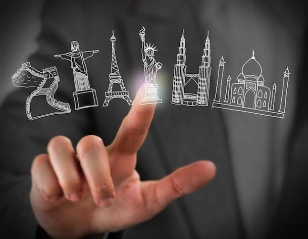 Closeup of female finger touching virtual symbol of famous touristic destination. Online booking concept