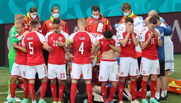 Danish national team players cover their partner from the cameras